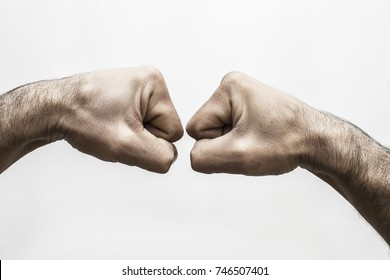 A close up image of a fist bump isolated on white background