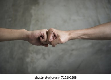 A close up image of a fist bump / Knuckle bump. Greeting and teamwork concept