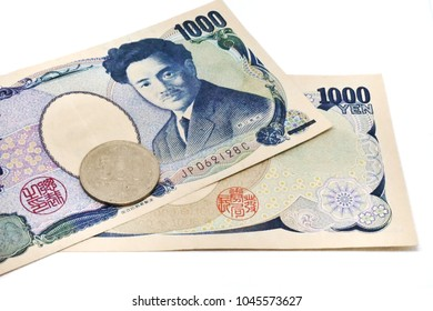 Close up image of front and rear Japan banknotes 1000 Yen with coin 500 Yen isolated on white background
