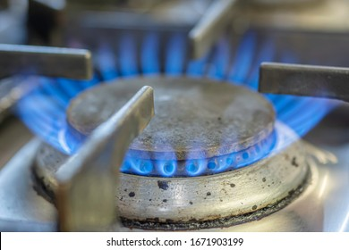 Close up image of gas flame burning on domestic kitchen hob.Global warming issue.Rising energy prices UK.Fossil fuels.Fuel and power industry.