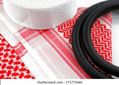 A close up image of a Ghutrah also known as the Keffiyeh along with the agal and skull cap. These items of clothing are usually worn by men as a head-dress in Arab Countries