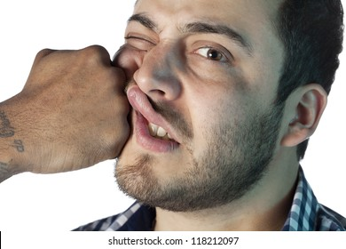 Close up image of guy face receiving a punch against white background