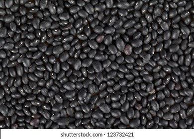 A close up image of heap black beans