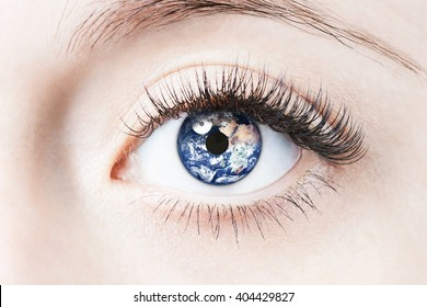 Close up image of human eye with earth in it. Elements of this image furnished by NASA