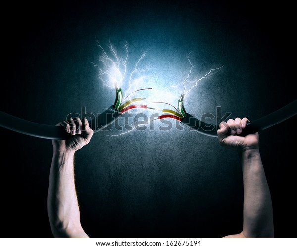 Close up image of human hand holding cable