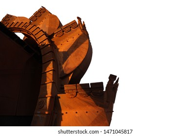 Close up image of industrial mining reclaimer bucket wheels machinery isolated white background construction mine site Perth, Australia