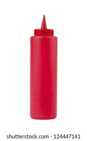 Close up image of a ketchup squeeze dispenser against white background