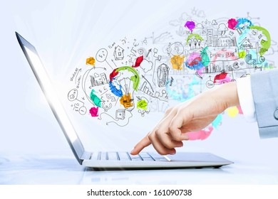 Close up image of laptop and human hands typing on keyboard