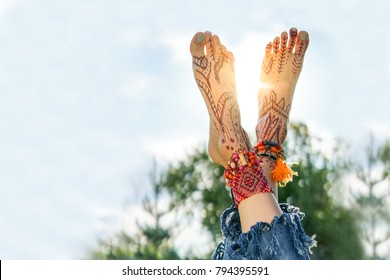 Close up image of man legs and foot over green lawn and sky background with backlight