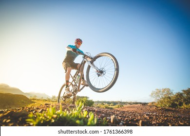 Close up image of a mountain biker speeding down a mountain bike trail in the montains.