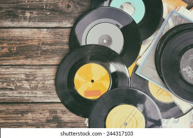 close up image of old records over wooden table