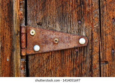 A Close Up Image Of A Old Rusted Antique Door Hinge.