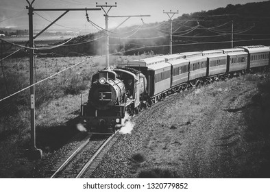Close up image of an old steam engine on a railway track in south africa