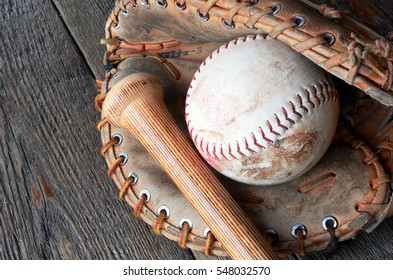 A close up image of old used baseball equipment.