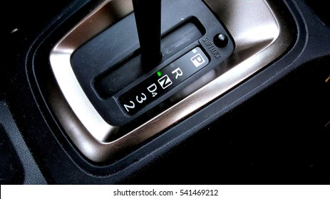 Close up image on hand auto gear on neutral mode.