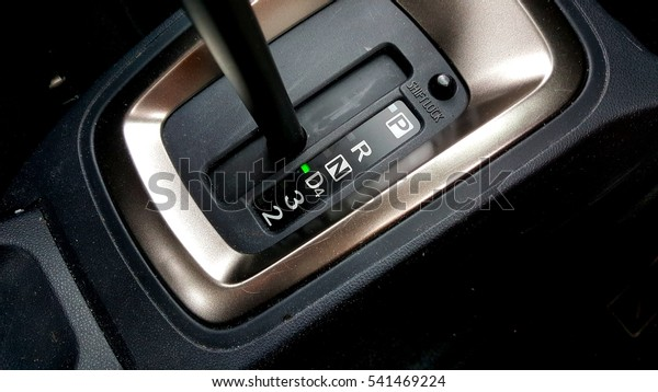 Close up image on hand auto gear on drive mode.