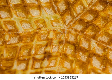 Close up image on a waffle with suger.
