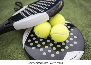 Close up image of paddle tennis balls and rackets