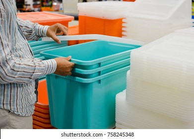 Close up image of person choosing selecting container on the indoors background. Buying, checking, preparing celebration, wholesale fabric production