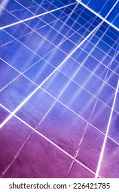 Close Up image of photovoltaic cells with crossing reflections and color effect, Sellected focus