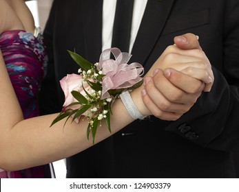 Close up image of pink corsage in a woman wrist