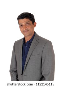 A close up image of the portrait of a east Indian business man in