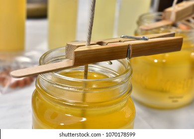 A close up image of pour home made wax candles.