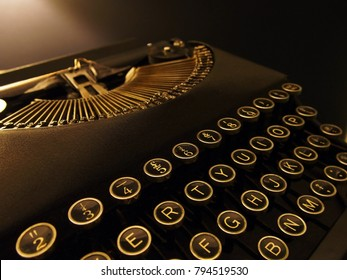Close Up Image of a Retro Vintage Typewriter, it has Beautiful Black and Gold Keys