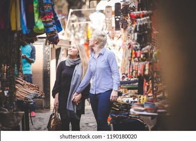 Close up image of a same sex female / lesbian couple enjoying sightseeing in the Cape Town South Africa city Center
