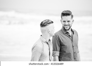 Close up image of a same sex or Gay male couple being loving and happy on the beach in Cape Town South Africa
