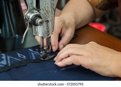 close up the image of seamstress working on the sewing machine
