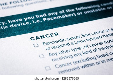 Close up image, selective focus on cancer disease content on health insurance questionnaire and application form. Healthcare, insurance policy, personal safety plan, business concepts.