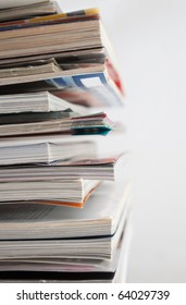 close up image of several magazines and books