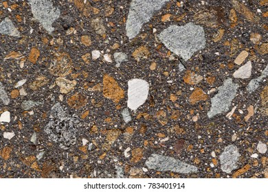 Close up image of a slab surface texture made of mixed small stones