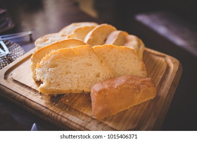Close up image sliced bread served on a wooden chopping board