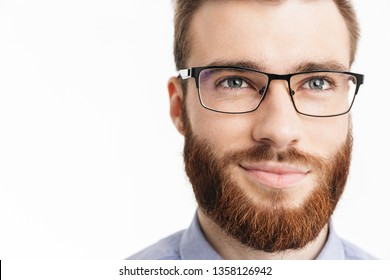 6c53b5783aaa Close up image of Smiling bearded elegant man in eyeglasses looking away  over grey background