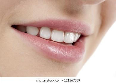Close up image of smiling female lips against white background