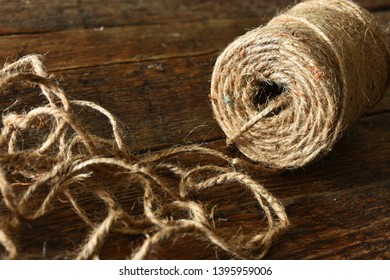 A close up image of a spool of brown craft twine.