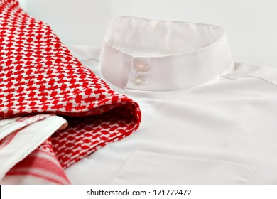 A close up image of a thaube or Kandura together with the Ghutrah also known as the Keffiyeh. These items of clothing are usually worn by men in Arab Countries