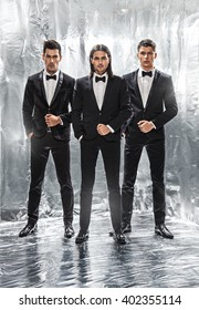 Close up image of three business men in black suit,silver background