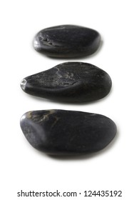 Close up image of three spa stones against white background