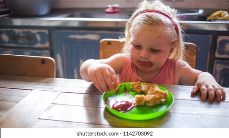 Close up image of a toddler girl enjoying a toasted cheese sandwich