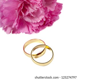 Close up image of two rings with pink flower isolated on white background