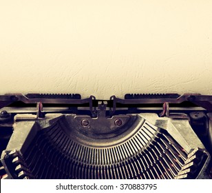 close up image of typewriter with paper sheet. copy space for your text. retro filtered