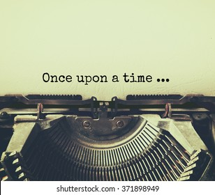 close up image of typewriter with paper sheet and the phrase: once upon a time . copy space for your text. retro filtered
