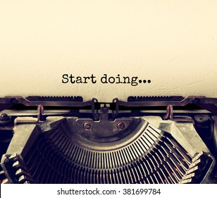 close up image of typewriter with paper sheet and the phrase: START DOING . copy space for your text. retro filtered