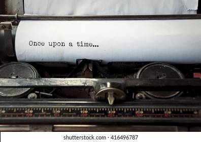 close up image of typewriter with paper sheet and the phrase: once upon a time. copy space for your text. retro filtered