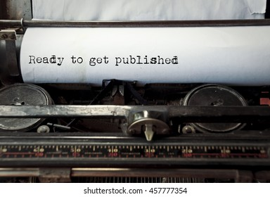 close up image of typewriter with paper sheet and the phrase: ready to get published. copy space for your text. retro filtered