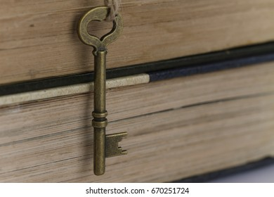 close up image of vintage/old key over stack of book. concept of key to succes