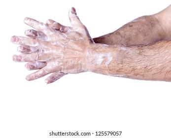 Close up image of washing hand against white background